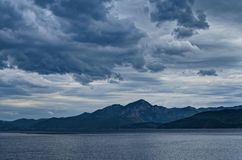 Mountain range and sea during thunderstorm Royalty Free Stock Photography