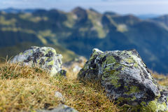 Mountain range with selective focus. Landscape of mountain range with selective focus on closeup rocks Royalty Free Stock Images