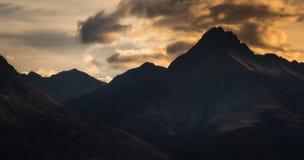 Mountain range. Silhouette of mountain range with clouds Royalty Free Stock Photos
