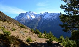 Mountain range with snow. Mountain ridge with snow against the blue sky. The area of mount Elbrus – the Kabardino-Balkarian Republic. Photo taken on: November Royalty Free Stock Photos