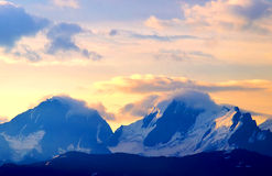 Mountain range and sundown Stock Images