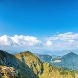 Mountain range under blue sky Stock Images