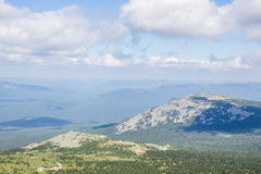 Mountain range under clouds. Shadow in summer day. Natural landscape background Stock Image