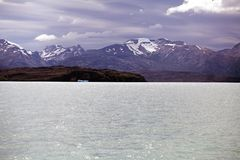 Mountain range view from the Argentino Lake, Argentina. Argentino Lake is the biggest freshwater lake in Argentina Stock Photos