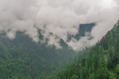 Mountain range view. Timelapse Of Moving Clouds And Fog over Himalayan mountain range in Sainj. Photo of mountain range view. Timelapse Of Moving Clouds And Fog royalty free stock photos