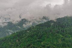 Mountain range view. Timelapse Of Moving Clouds And Fog over Himalayan mountain range in Sainj. Photo of mountain range view. Timelapse Of Moving Clouds And Fog stock image