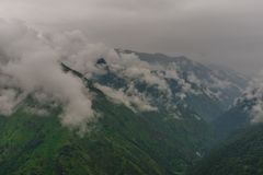 Mountain range view. Timelapse Of Moving Clouds And Fog over Himalayan mountain range in Sainj. Photo of mountain range view. Timelapse Of Moving Clouds And Fog royalty free stock photography