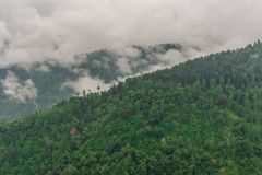 Mountain range view. Timelapse Of Moving Clouds And Fog over Himalayan mountain range in Sainj. Photo of mountain range view. Timelapse Of Moving Clouds And Fog stock photos