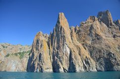 Mountain range, volcanic lava rising from the sea stock images