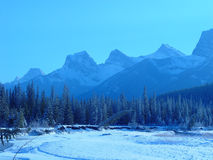 Mountain range in winter. A frozen river bed with  The Three Stock Photography