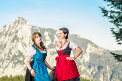 Mountain Range and Young Woman. Mountain range and young women with traditional austrian clothes Royalty Free Stock Photo