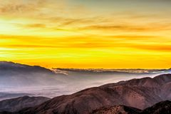 Amazing Yellow Sunset Over the Desert Royalty Free Stock Photography