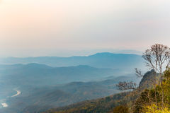 Mountain ranges in the haze at dawn Royalty Free Stock Images