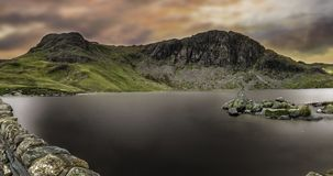 Mountain ranges with lake on top. royalty free stock photos