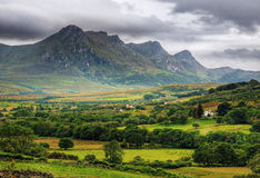 Mountain Ranges in Northern Scotland. This picture show a mountain range in northern Scotalnd on a cloudy day Stock Photo