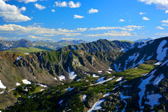 Mountain Ranges In Summer with Pine Trees and Large Patches of S stock images