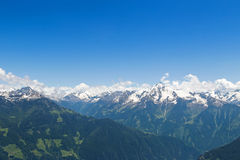Mountain ranges of the Zillertal with snow and blue sky during s Stock Photography