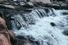 Clear water of a mountain river. The picturesque nature of the Rocky Mountains. Colorado, United States. Mountain rapids in the Rocky Mountains. Rocky Mountain Royalty Free Stock Image