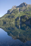 Mountain reflecting in lake Stock Image