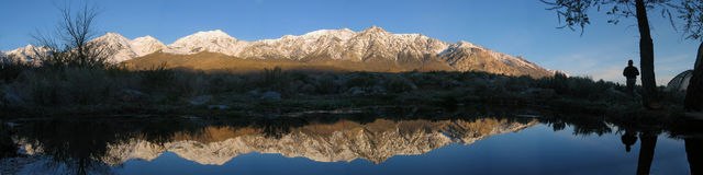 Mountain reflection. Mount Mary Austin and other morning sunlit sierra mountains reflected in a pool Stock Images