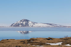 Mountain reflection on blue lake with clear sky background, Iceland Royalty Free Stock Photo