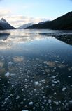 Mountain reflection, brash ice Stock Photos