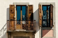 Mountain reflection in classic apartment balcony windows with op royalty free stock images