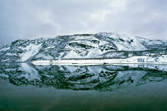 The Mountain reflection in a Fjord in Norway Royalty Free Stock Photo
