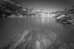 Mountain reflection in a glacier lake black and white Stock Images