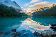 Mountain reflection on the lake. Mountain reflection on lake Louise at sunrise, Banff , canada Stock Photos