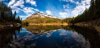 Mountain reflection on lake Stock Photo
