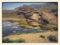 Mountain reflection on lake. Green water Stock Image