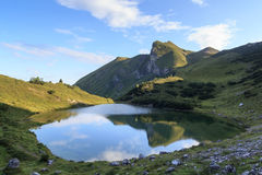 Mountain with reflection in lake Stock Images