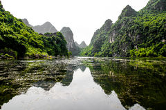 Mountain reflection. Reflection between mountain and lake in Vietnam royalty free stock photo