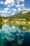 Mountain Reflection in motionless Ink Pot. Beautiful mountain landscape reflection in perfectly calm turquoise water Stock Photos