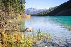Mountain reflection. Mountains reflected in Lake Louise, Alberta, Canada Stock Photos
