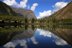 Mountain reflection, Nepal Stock Photos