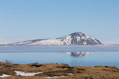 Mountain and reflection over the lake with clear blue sky background, Iceland Stock Photo