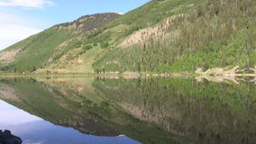 Mountain Reflection. A scenic reflection of the Colorado mountains in summer stock footage