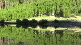 Mountain Reflection in Summer. A scenic reflection of the Colorado mountains in summer stock footage