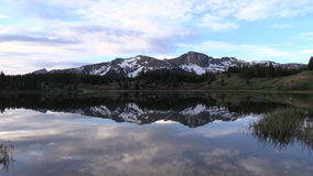 Mountain Reflection at Sunrise. A scenic reflection of the Colorado mountains in summer stock footage