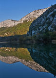 Mountain reflection in water Stock Image