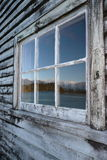 Mountain reflection in window, Stock Photography