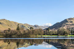 Mountain reflections in the brathay bay Royalty Free Stock Photo