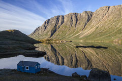 Mountain reflections in fiord. Beautiful mountains reflects in the calm morning light in a Greenland fiord Stock Photo