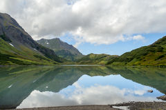 Mountain reflections. I took this picture at Upper Hazel lake in Alaska Stock Images
