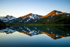 Mountain reflections. I took this mountain reflection picture from Upper Hazel lake across the bay from Homer Alaska Stock Image