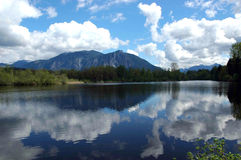 Mountain reflections in lake. A beautiful landscape view across a lake at Mount Si in North Bend, Washington with a perfect reflection in the calm waters of the Stock Image