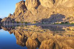 Mountain with reflections in a river, Fint Oasis. Royalty Free Stock Image