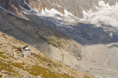 Mountain Refuge. The remote mountain refuge Couvercle in the mont blanc massif in the french alps. Set in a wild location with the aiguille du Triolet in the Stock Image